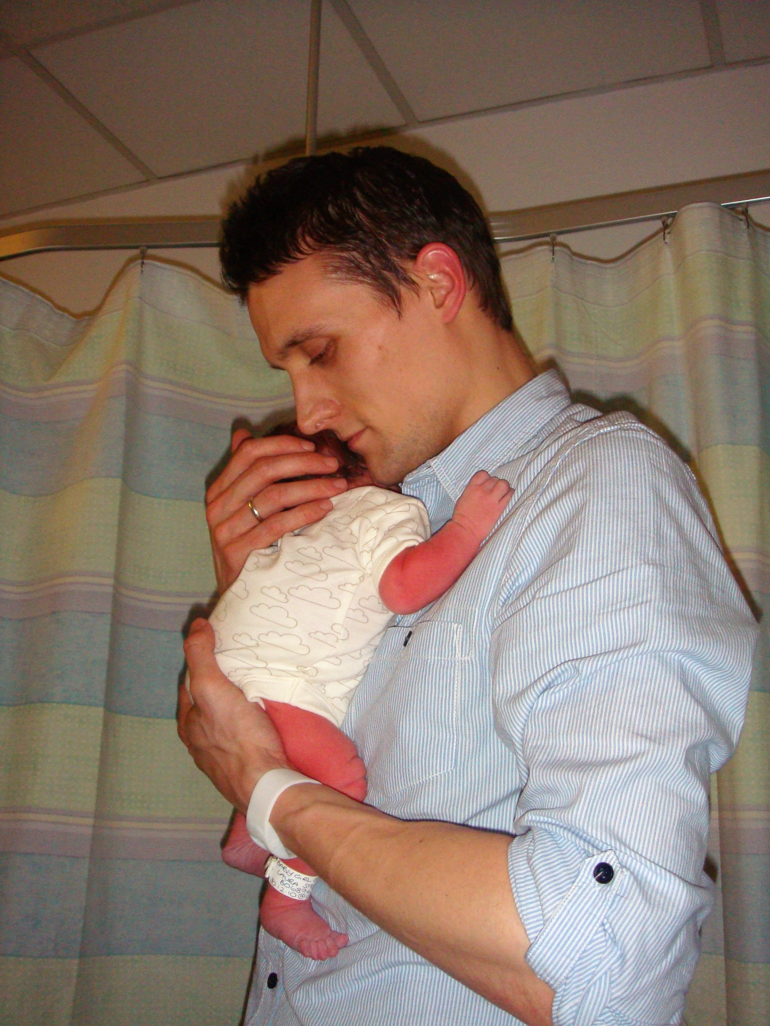 Becoming Dad Paternity leave holding newborn
