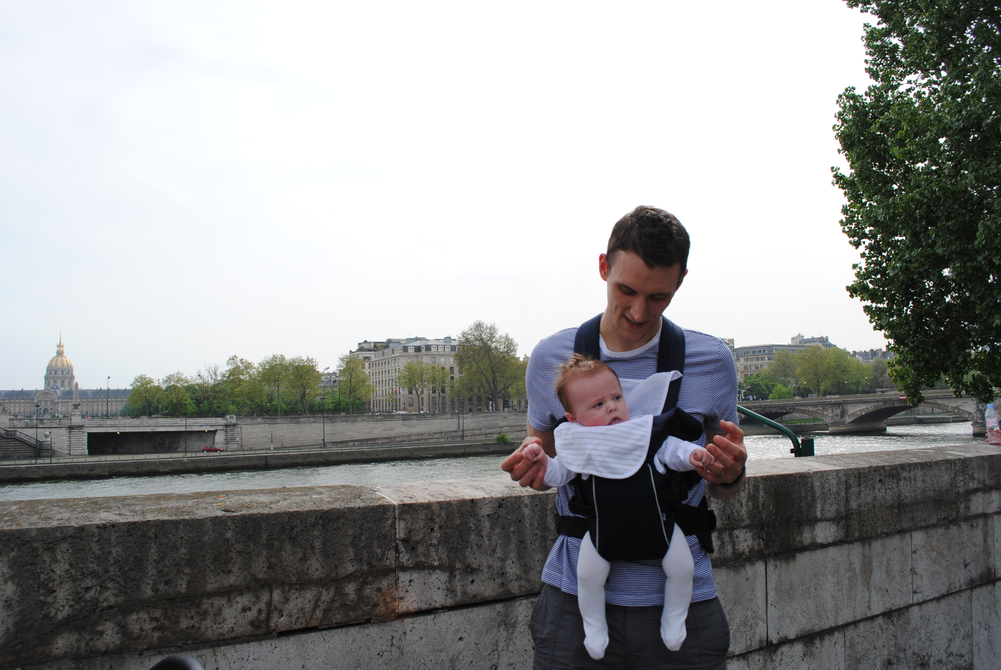 Travel Paris with a baby in a sling carrier