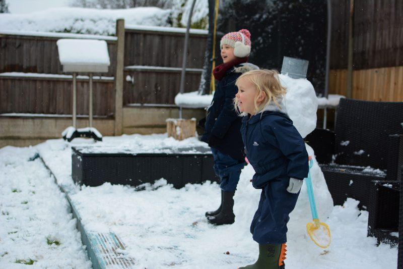 sisters siblings snow