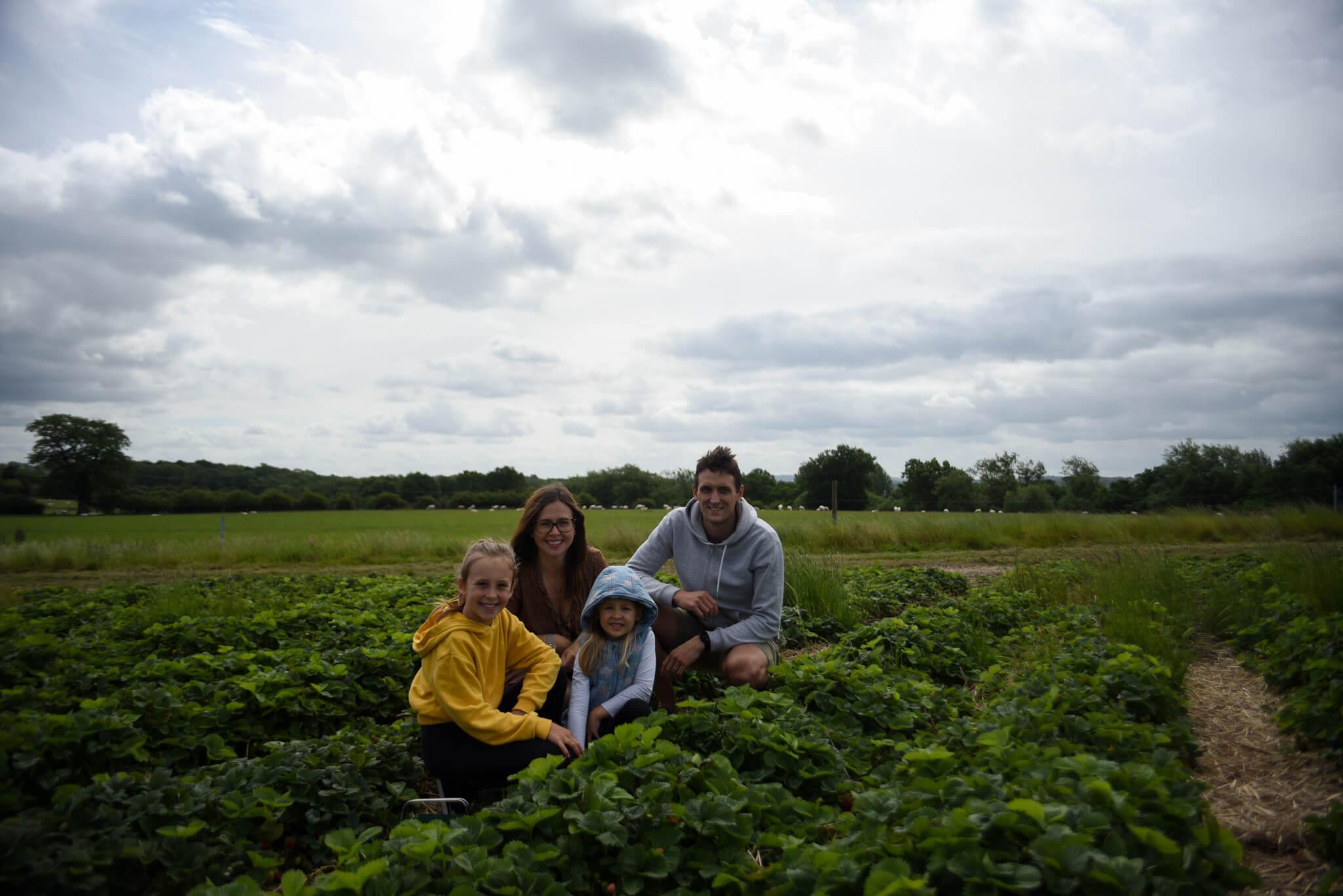 family photo fruit picking